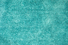 Texture of turquoise rug made of cotton wool. Detail of texture of turquoise rug made of cotton wool Stock Image