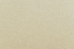 Texture of unbleached linen fabric, background. Wallpapper or background - structure of unbleached canvas, sailcloth, white, brown Royalty Free Stock Photo