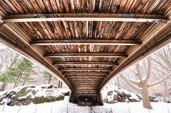 Texture underneath Central Park bridge. View of wood grain and construction detail underneath bridge in Cental Park, New York City stock images