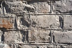 Uneven vintage brick wall. Texture of an uneven vintage brick wall stock photo