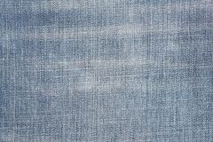 Texture usée de blues-jean Fond de tissu de denim Image stock