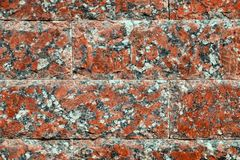 Background, texture, masonry red natural stone of marble chips. royalty free stock photo