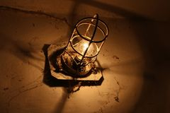 Old industrial lamp in an abandoned basement. royalty free stock image