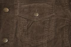 Texture of an old corduroy jacket, corduroy pocket and buttons. stock photo