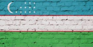 Texture of Uzbekistan flag. Of on a brick wall stock image