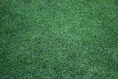Texture verte d'herbe du football Photographie stock