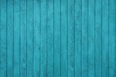 Texture of vertical boards in blue fence stock photo