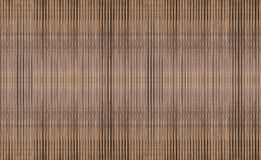 Texture of the vertical stripes of a bulk bundle of bamboo rods are repeated creating a ribbed textured Stock Image