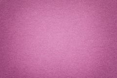 Texture of old purple paper background, closeup. Structure of dense cardboard. Texture of vintage dark purple paper background with vignette. Structure of dense stock images
