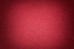 Texture of old bright red paper background, closeup. Structure of dense cardboard. Texture of vintage dark red paper background with vignette. Structure of dense royalty free stock image