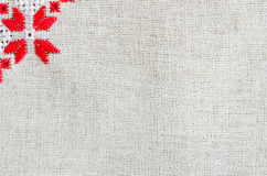 Texture of the vintage homespun linen textile. Background with embroidery. Royalty Free Stock Images