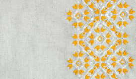 Texture of the vintage homespun linen textile with embroidery. Design of ethnic pattern. Craft embroidery. Royalty Free Stock Photo