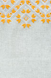 Texture of the vintage homespun linen textile with embroidery. Design of ethnic pattern. Royalty Free Stock Photo