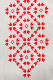 Texture of the vintage homespun linen textile with embroidery. Design of ethnic textures. Stock Photo
