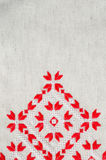 Texture of the vintage homespun linen textile with embroidery. Design of ethnic textures. Royalty Free Stock Image