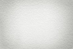 Texture of old light white paper background, closeup. Structure of dense cardboard. Texture of vintage light white paper background with vignette. Structure of royalty free stock images