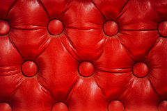 Texture of vintage red leather upholstery with buttons Stock Images