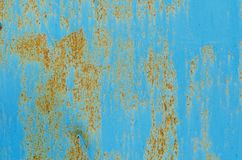 Texture of vintage rusty blue and gray iron wall background with many layers of paint. And rust Royalty Free Stock Photos