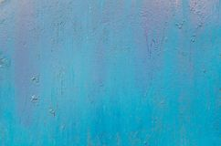 Texture of vintage rusty blue iron wall background with many layers of paint. And rust royalty free stock images
