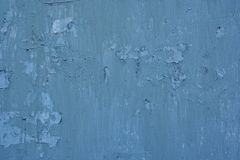 Texture of vintage rusty blue and gray iron wall background with many layers of paint. Texture of vintage rusty gray iron wall background with many layers of Stock Photos