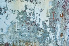 Texture of vintage rusty blue and gray iron wall background with many layers of paint. Texture of vintage rusty gray iron wall background with many layers of Stock Images