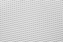 Texture of vinyl paper perforated sheets white color. Royalty Free Stock Images