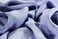 Texture of violet silk fabric with beads royalty free stock photography