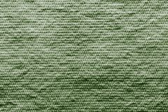 Texture wadded fabric of green color Stock Photography
