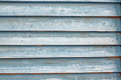 Texture of wall of blue boards with flaky paint Stock Images