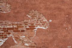 Texture of the wall with bricks. Brown texture of the wall with bricks for background stock image