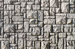 Texture of a wall built of granite stones stock photos