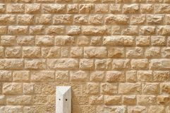 Texture of the wall built of rough yellow stone blocks. In Jerusalem stock photography