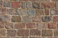 Texture of a wall with cobblestones and mortar Royalty Free Stock Image
