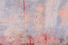 Texture of a concrete wall with cracks and scratches which can be used as a background. Texture, wall, concrete, it can be used as a background. Wall fragment stock photography