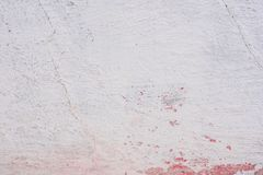 Texture of a concrete wall with cracks and scratches which can be used as a background. Texture, wall, concrete, it can be used as a background. Wall fragment royalty free stock image