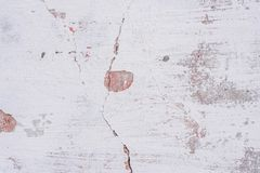 Texture of a concrete wall with cracks and scratches which can be used as a background. Texture, wall, concrete, it can be used as a background. Wall fragment stock images