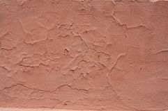 Texture of wall covered with dark red plaster Stock Photo