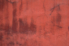 Texture of wall covered with dark red plaster Stock Photography