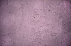 Texture of wall covered with lilac stucco Stock Photos