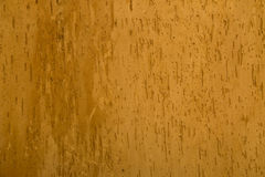 Texture of a wall covered with orange stucco Stock Photos