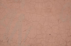 Texture of wall covered with peeling pink stucco Royalty Free Stock Photos