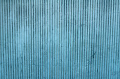 Texture of wall covered plaster with blue vertical relief. Texture of old wall covered plaster with blue vertical relief stock photography