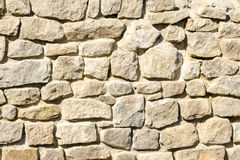 Wall made ​​of crushed rocks Stock Photo