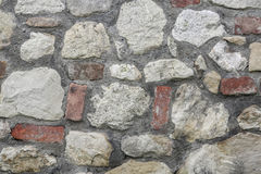 Texture of wall made of irregular stones Stock Photography