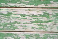 Texture of wall made of planks with  green paint peeling off Royalty Free Stock Image