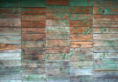 Texture of wall made of planks with paint peeling off Stock Photography