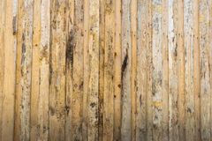 Texture of the wall made of wooden boards arranged vertically, the surface of the wood is poorly worked, many wood fibers and Stock Photography
