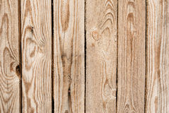 Texture of the wall made of wooden boards arranged vertically, the surface of the wood is poorly worked, many wood fibers and Royalty Free Stock Photos