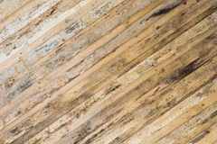 texture of the wall made of wooden planks arranged diagonally, the surface of the wood is poorly treated, many wood fibers and Royalty Free Stock Photo