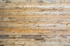 The texture of the wall made of wooden planks located horizontally, the surface of the wood is poorly treated, many wood fibers an Royalty Free Stock Photos
